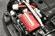 The engine block is very, very wrong. The valve cover and details are fairly correct. Detailing the valve cover, and Alclad chroming the header helped make this a convincing engine.