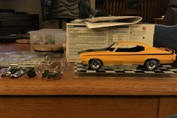I worked on modifying the Buick's suspension in order to center the rear wheels in the wheel wells. I was able to land the axle in the right place however, I didn't scrape away the original glue. The result was more ride height in the rear than I wanted.
