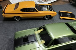 """I needed to continue the hood """"decals"""" to the cowl. Using the hood as a template, I was able to easily extend the lines using masking tape."""