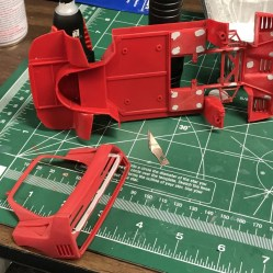 Once I decided it was time to start building the F40, I stripped the paint from the initial work and started filling in sink marks.