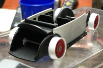 After I modified the chassis for ride height, I glued the axles in place.