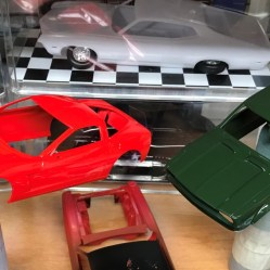 Once the primer was cured, I sprayed the model with decanted Tamiya British Racing Green.
