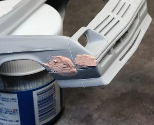 After I cut the new detail into the side of the charger, I added filler to smooth the transition between the fender and the body molding. I also needed to fill in the original bumper detail.