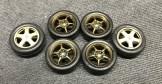 I sprayed the Mugen wheels my custom blend of bronze and sealed them with Tamiya smoke.
