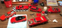 Once I finished the panel lines on the Golf, I mixed a dark shade of red for the '12 Corvette and decided to pull all of my completed red kits and darken panel lines.