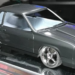 I hate to say it, but I don't really like the way this looks. Maybe it's the charger, or the color, or both. I plan on spraying either Tamiya gunmetal, light gunmetal or even dark blue metallic. Time will tell.