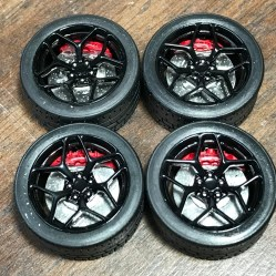 I applied decals to the calipers and attached the rotors to the wheels. These things look amazing!