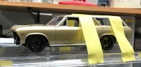 Once I was ready to glue the wheels to the Chevelle, I used epoxy and the held the model in place with tape while ensuring proper alignment.