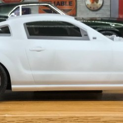 I may use the wheels from the next generation Mustang GT. They look more to scale than the kit wheels.