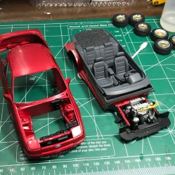 The interior and chassis are complete. Sanding and polish on the body are in progress.