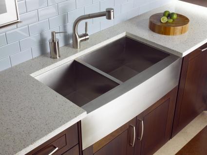 kitchen with stainless steel undermount sink glass countertop, backsplash