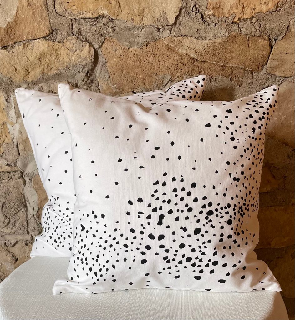 White cotton pillow with black spots throughout at Impressive Windows & Interiors in Hastings MN