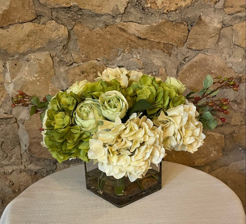 Botanical Hydrangea Bouquet with rose cuttings and rosehip buds in glass vase Impressive Windows and Interiors Hastings, MN