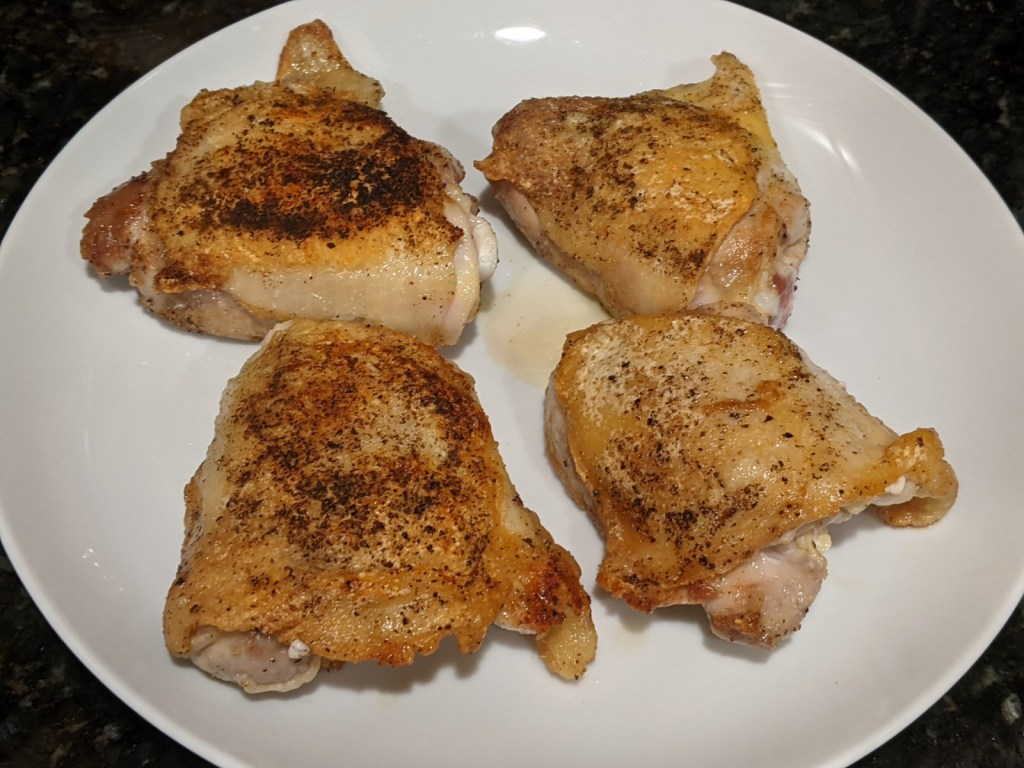 Transfer chicken to a plate and pour off half the fat from the skillet.