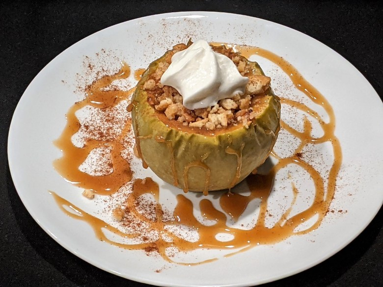 Enjoy cheesecake in a baked apple smothered in homemade caramel sauce!