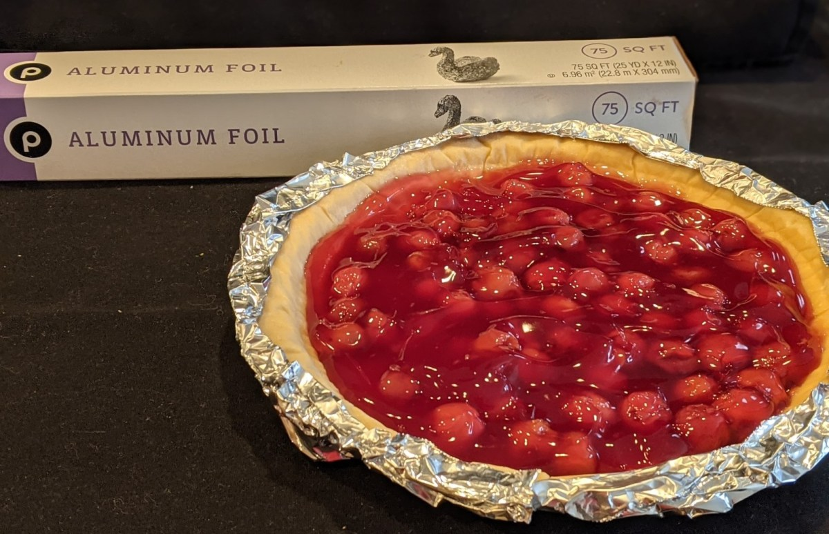 foil and pie with egdes wrapped in foil