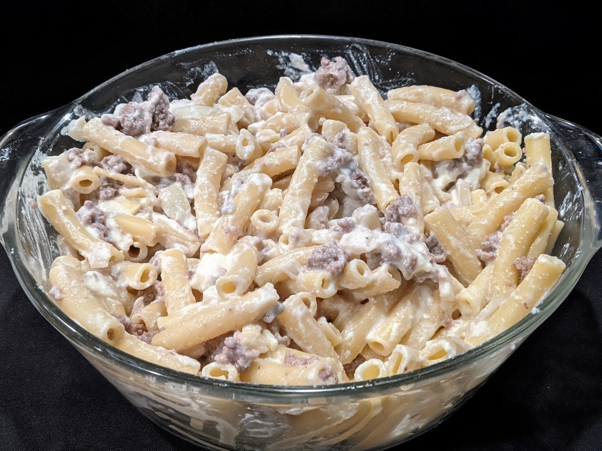Easy baked ziti. Mix ricotta and shredded mozzarella cheese with pasta and ground beef.  ImpressNotStress