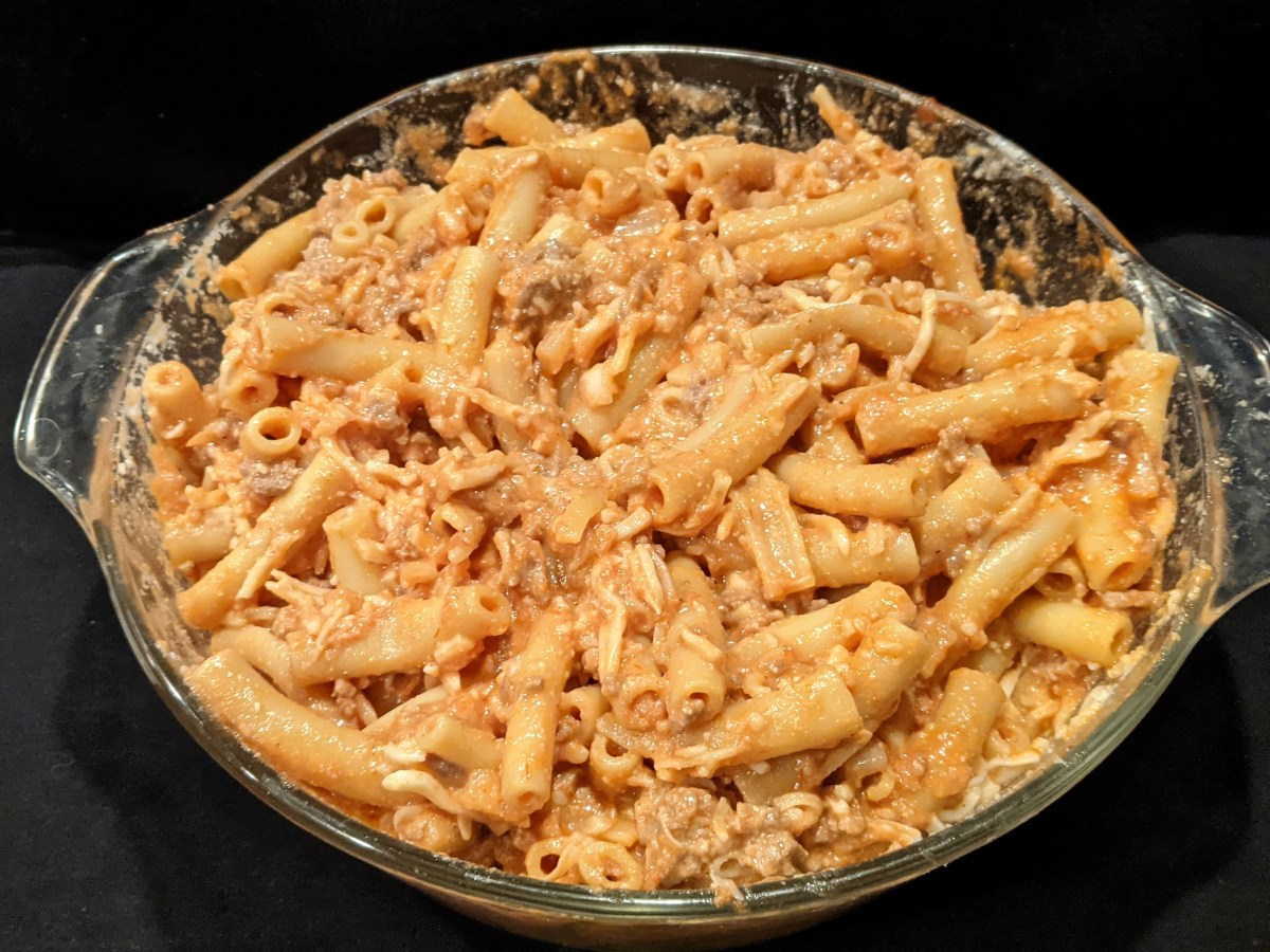 Easy baked ziti. ImpressNotStress.  Mix pasta sauce with cooked ziti, ground beef and cheese mixtures.