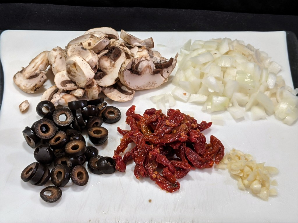 Sliced mushrooms, chopped onions, sliced olives, sundried tomato slices and minced garlic.