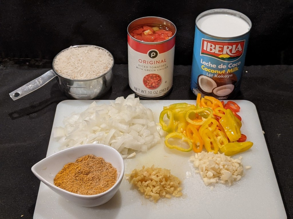 Before starting, make sure the onion is chopped, the garlic & ginger are minced and the peppers are sliced. Measure out your spices and assemble the other ingredients (open the can of diced tomatoes and coconut milk).
