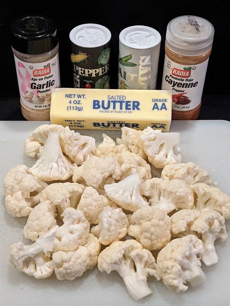 Cauliflower florets, butter, garlic powder, pepper, salt and cayenne pepper