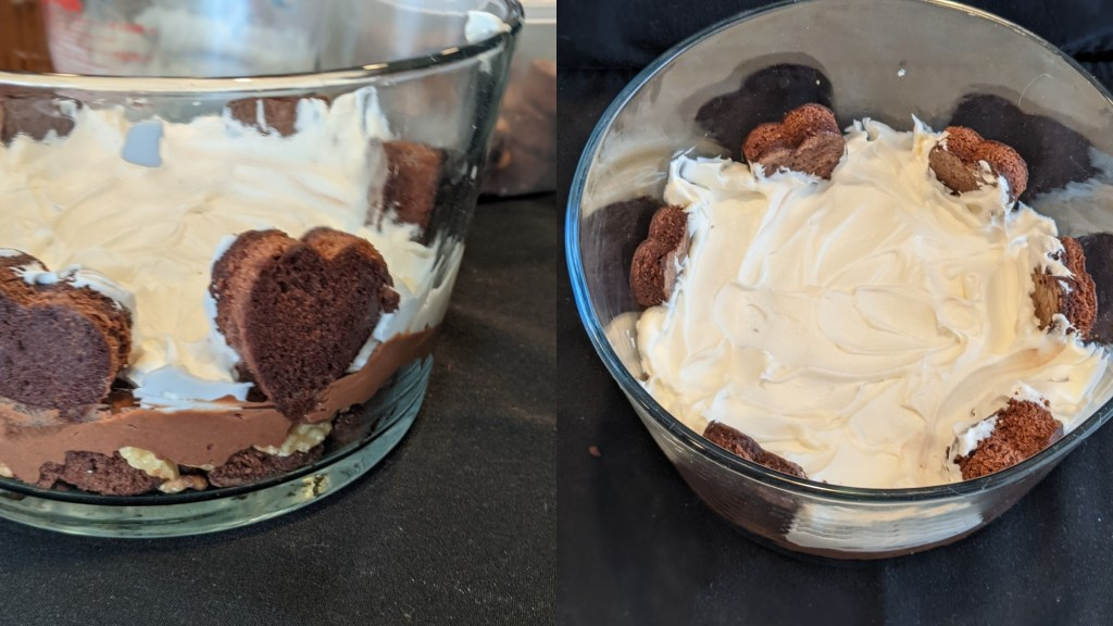trifle bowl with brownie hearts and a layer of the whipped topping