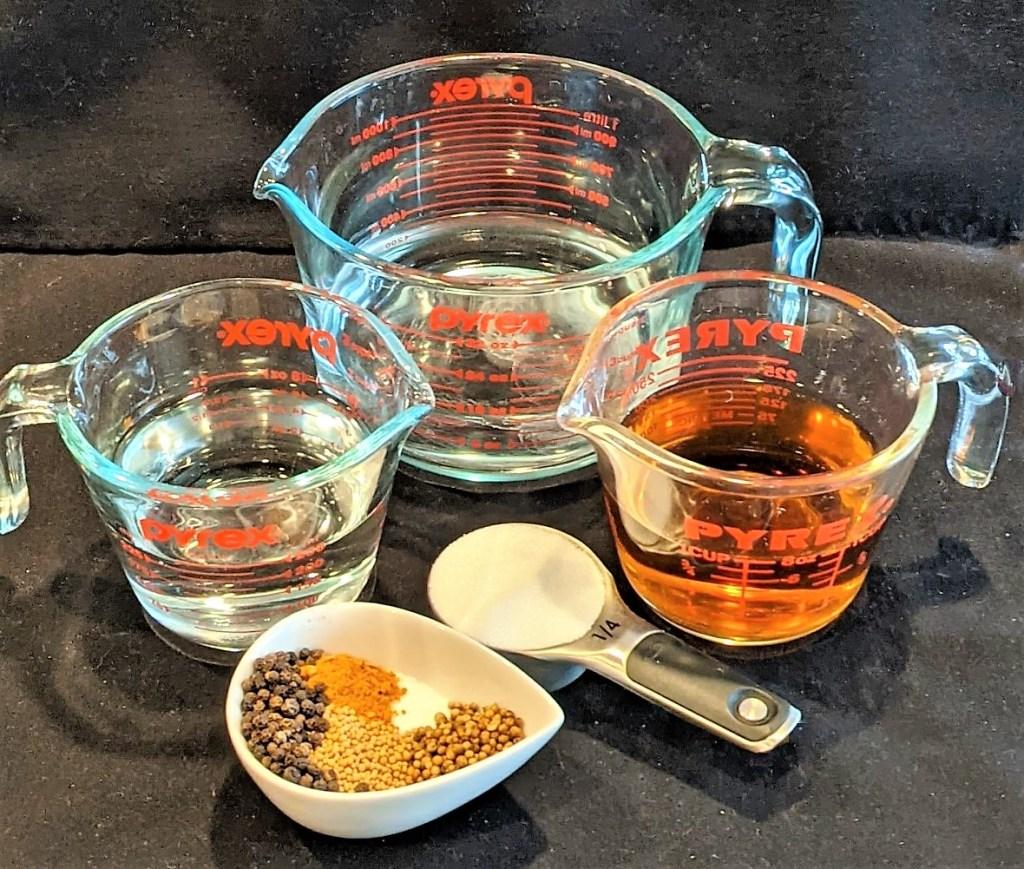 Measured vinegars, water, sugar, salt & spices