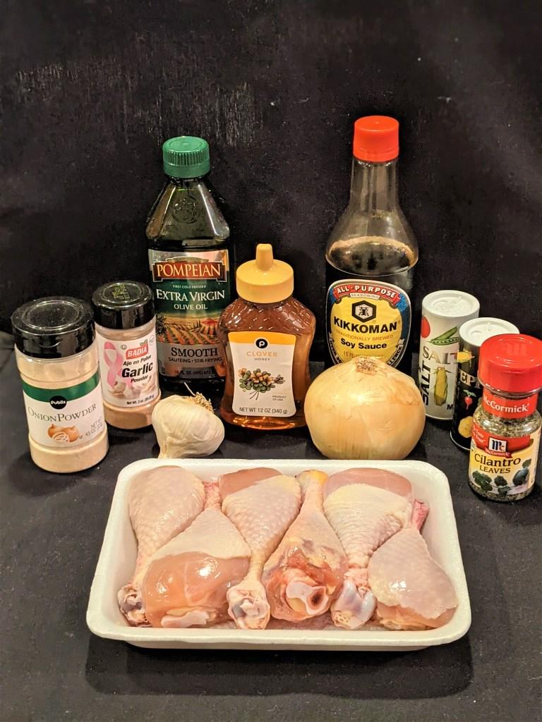 Chicken drumsticks, onion, garlic, honey, soy sauce, olive oil, garlic powder, onion powder, salt & pepper and cilantro