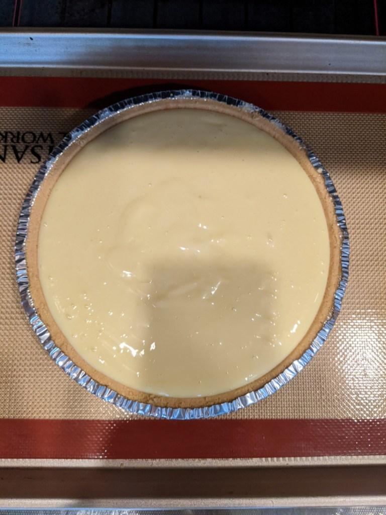 Filled pie crust on a baking sheet