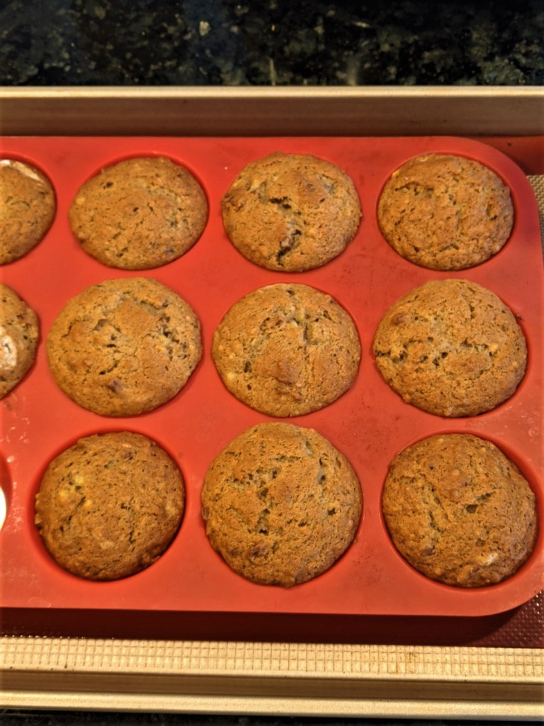 Baked muffins in silicone pan on baking sheet