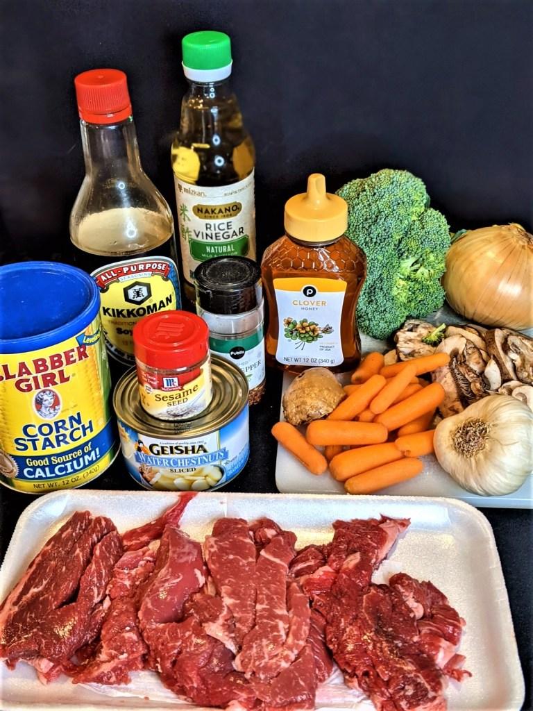 Ingredients displayed: sirloin strips, vegetables, seasonings, honey, water chestnuts