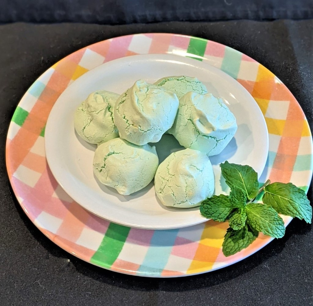 Cookies on plate, garnished with mint leaves