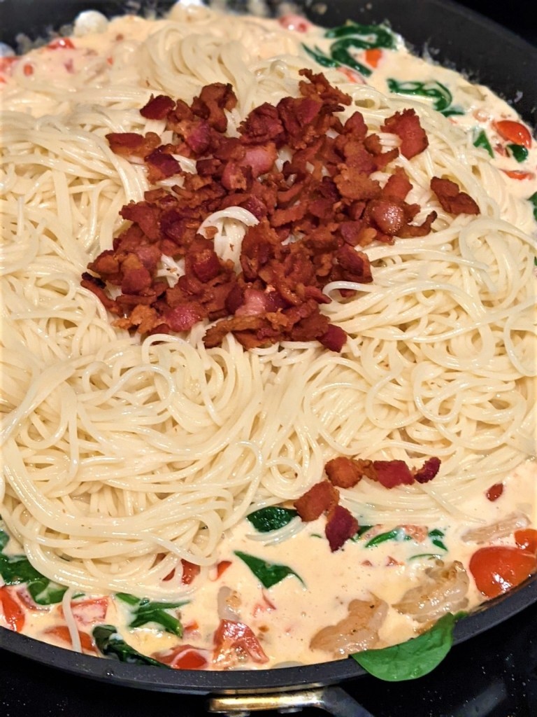 pasta and bacon added to skillet