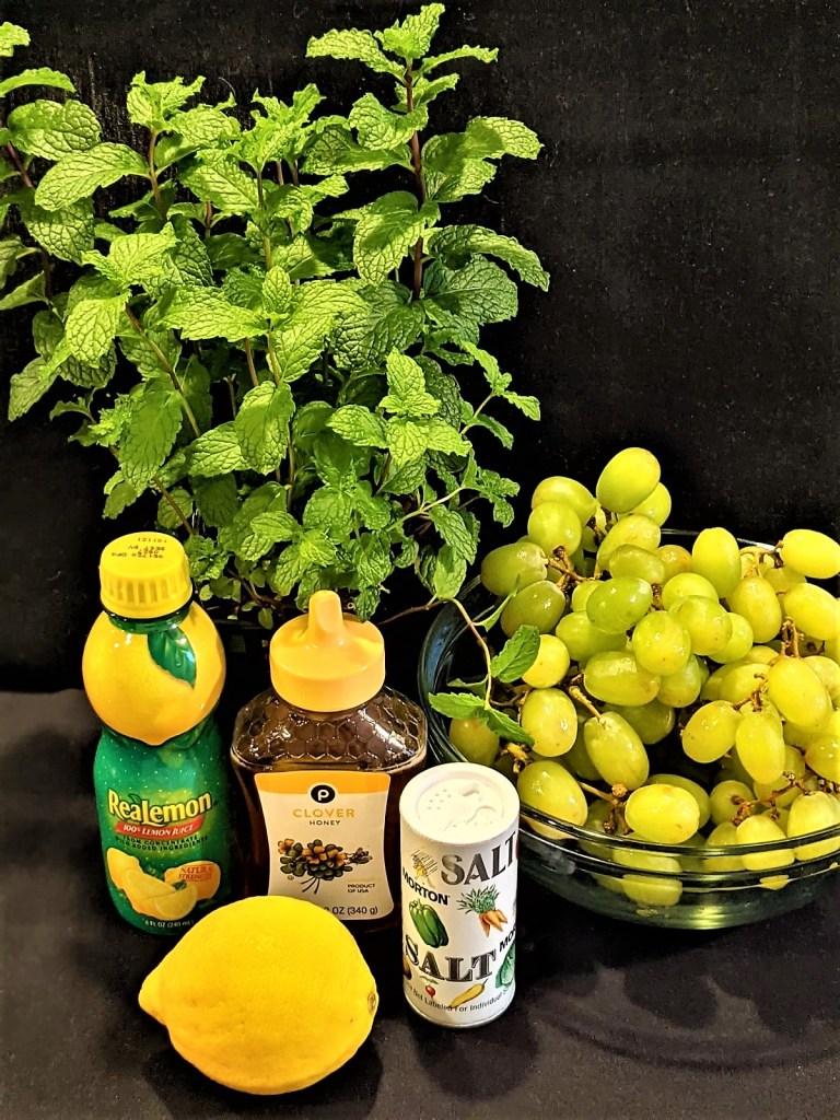 Picture of lemon, grapes honey, lemon juice, fresh mint and salt