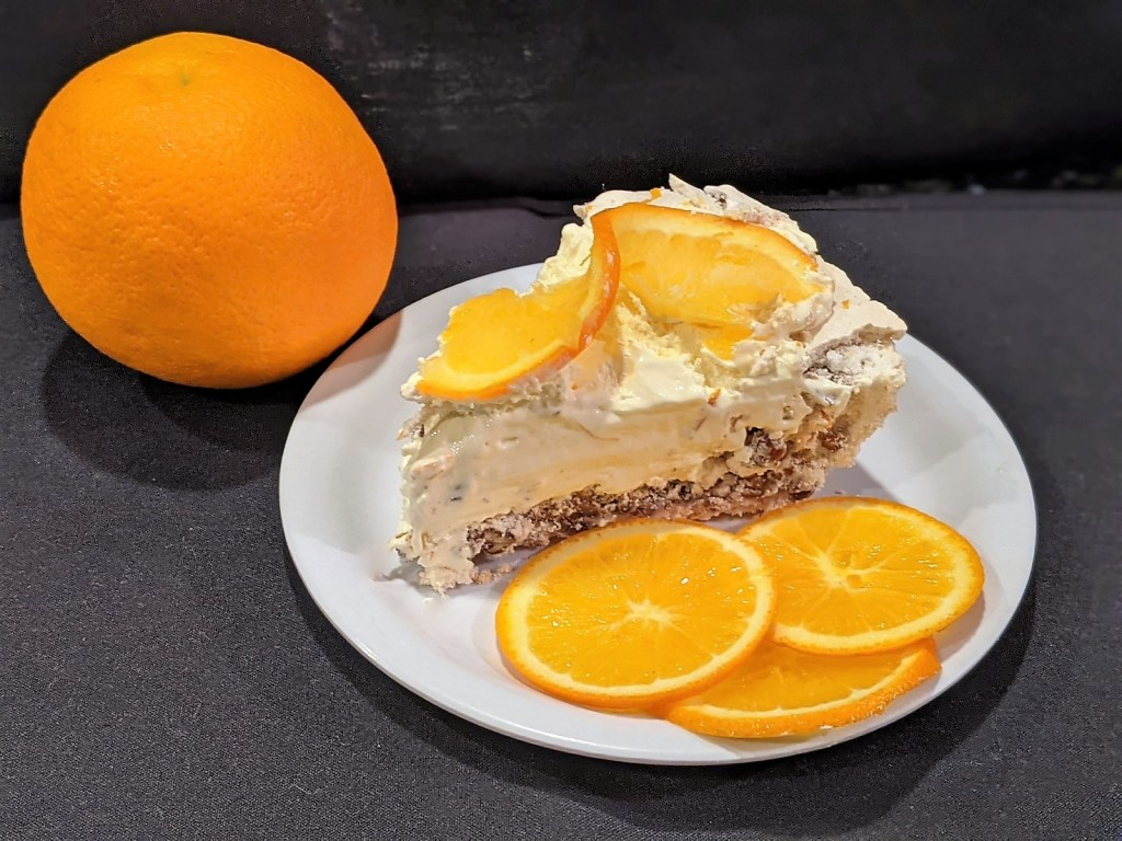 Orange and a slice of pie