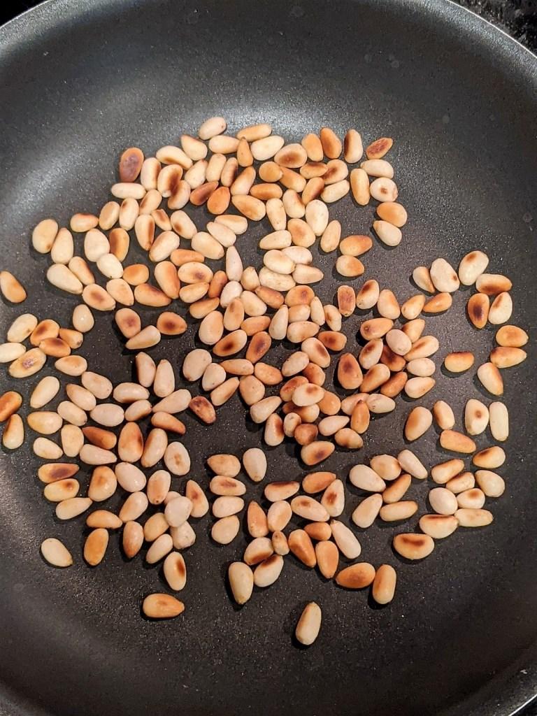 pine nuts in saute pan