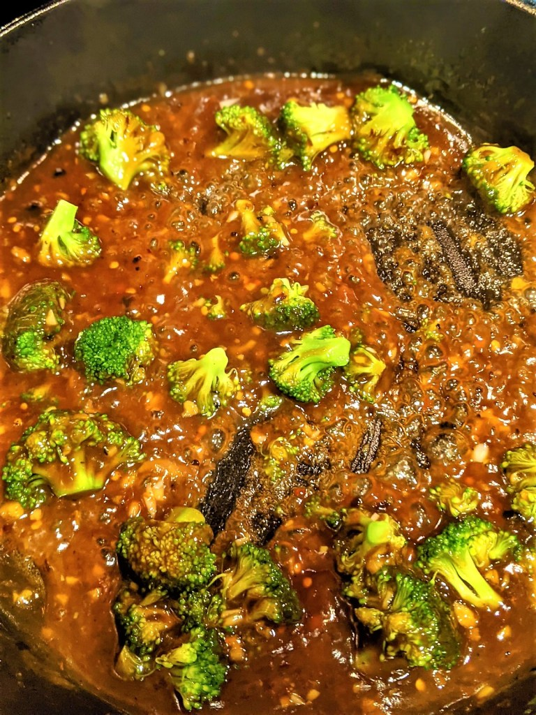 broccoli in skillet with sauce