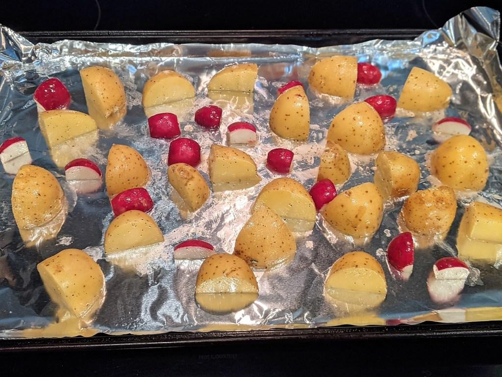 potatoes and radishes on baking pan