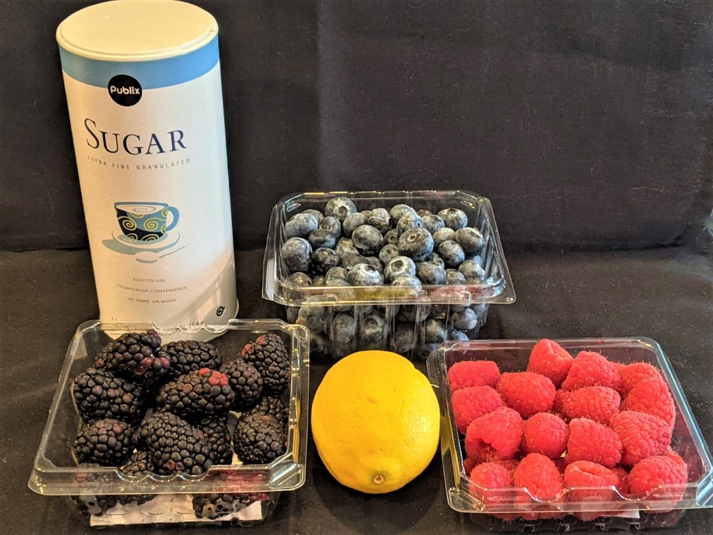 Ingredients for topping: berries, sugar and lemon