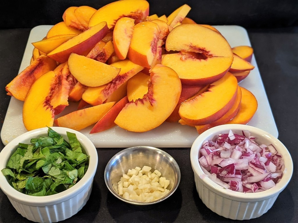 prepped peaches, basil, garlic and onions
