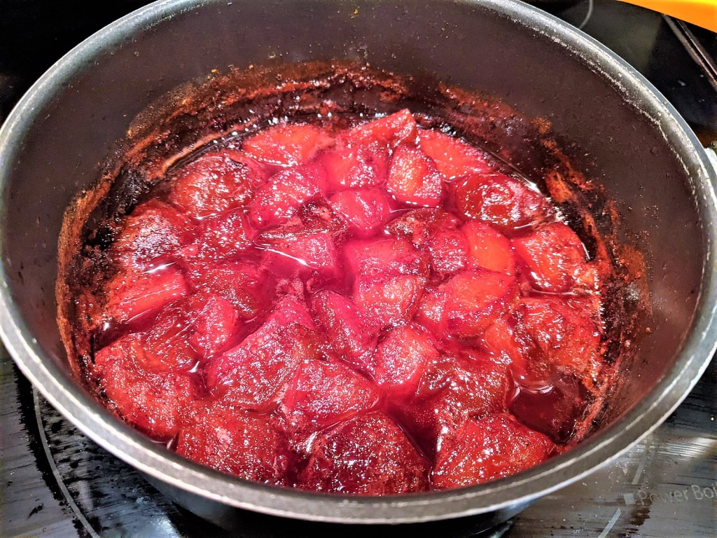 poached plums in pan