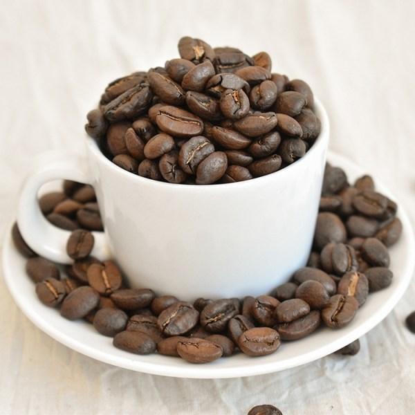 Espresso beans in an espresso cup