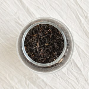 Mangalam black tea leaves in a jar