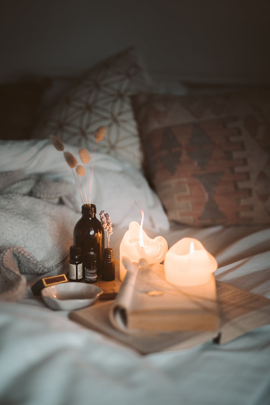 lighted candles in the bedroom