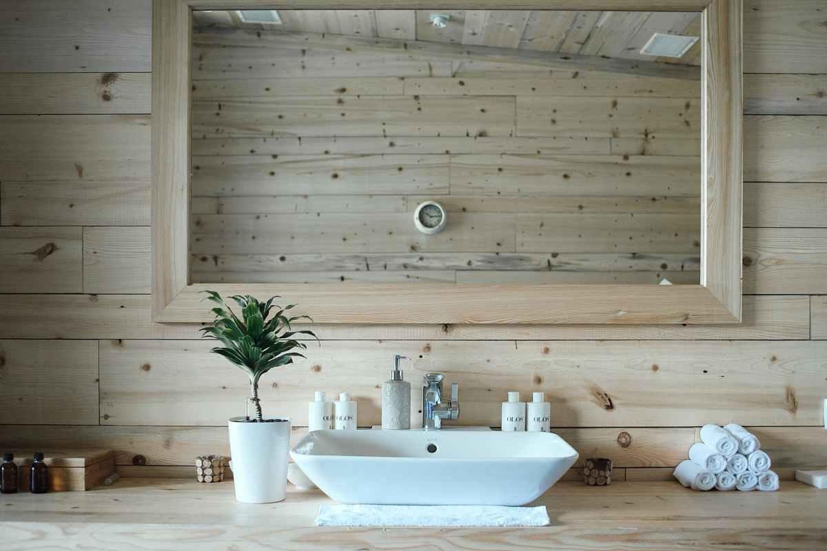 interior of modern stylish bathroom with wooden walls