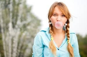 A young woman gets a portrait photo tip when using bubblegum as a prop.