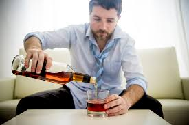 image of man pouring alcohol
