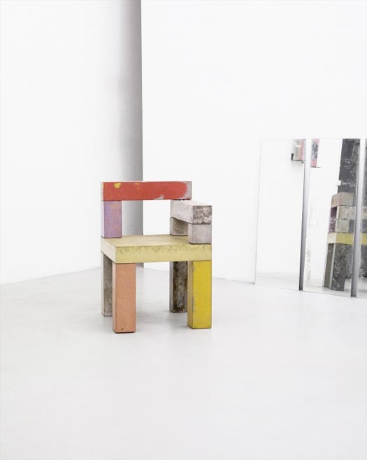 chairs made from colorful concrete beams