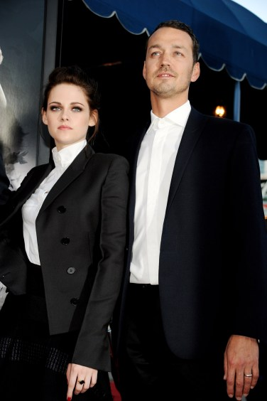 """LOS ANGELES, CA - MAY 29: Actress Kristen Stewart (L) and director Rupert Sanders arrive at a screening of Universal Pictures' """"Snow White and The Huntsman"""" at the Village Theatre on May 29, 2012 in Los Angeles, California. (Photo by Kevin Winter/Getty Images)"""