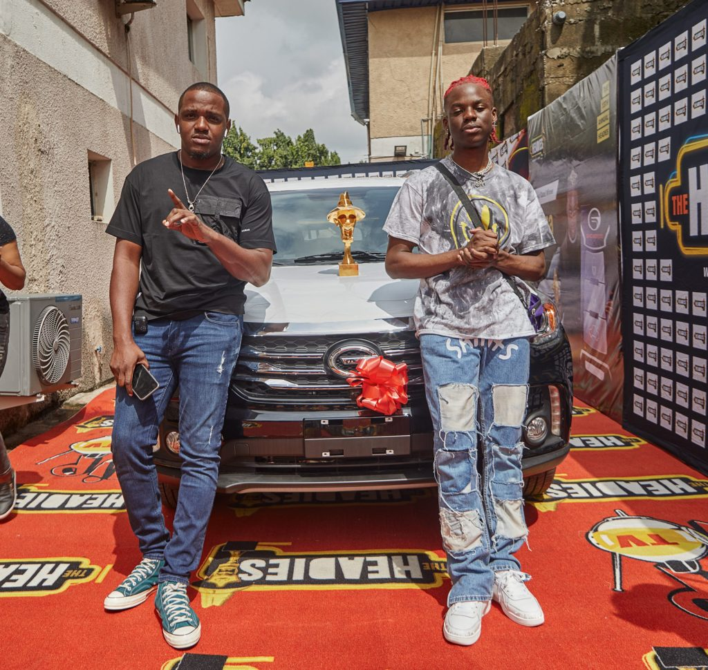 REMA & his Manager Smiles as the artist picks up his Next Rated Car from Headies Awards Organizers